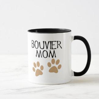 Mamá grande de Bouvier de las patas Taza