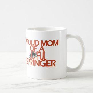 Mamá orgullosa de un saltador alegre tazas de café