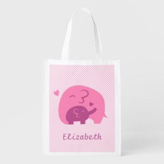 Mamá y niño elegantes del elefante de la silueta bolsas para la compra