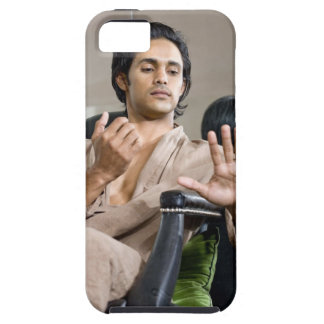 Man admiring his manicure iPhone 5 cover