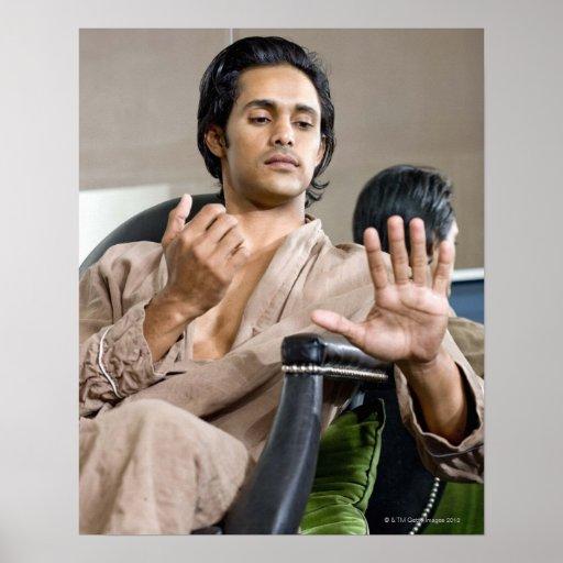 Man admiring his manicure print