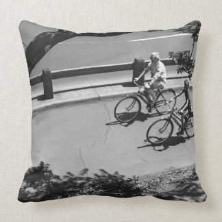 Man and Boy Cycling Throw Pillow