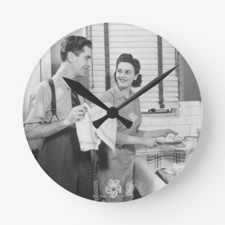 Man and Woman Doing Dishes Round Wallclock