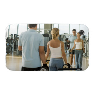 Man and woman lifting hand weights in front of a Case-Mate iPhone 3 cases