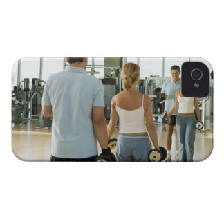 Man and woman lifting hand weights in front of a Case-Mate iPhone 4 case