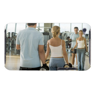 Man and woman lifting hand weights in front of a iPod touch cover