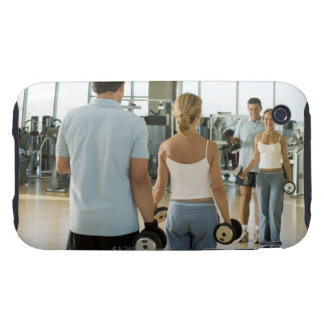 Man and woman lifting hand weights in front of a tough iPhone 3 case