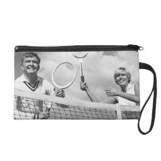 Man and Woman Playing Tennis Wristlet Clutches