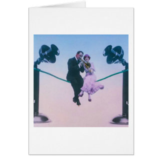 Man and woman sit on telephone wire 1900 card