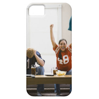 Man and woman sitting on sofa watching football iPhone SE/5/5s case
