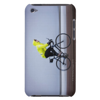 Man bicycles on a cold and foggy winter day. iPod Case-Mate cases