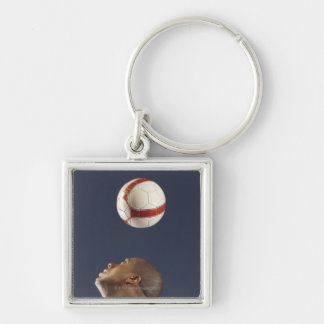 Man bouncing soccer ball on his head 2 keychain