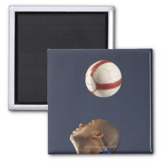 Man bouncing soccer ball on his head 2 2 inch square magnet
