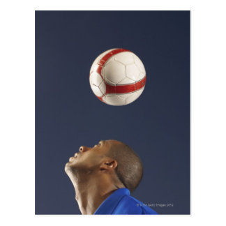 Man bouncing soccer ball on his head 2 postcard