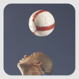 Man bouncing soccer ball on his head 2 square stickers