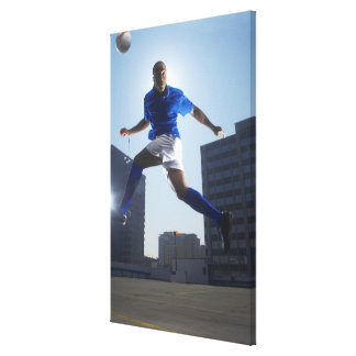 Man bouncing soccer ball on his head gallery wrapped canvas