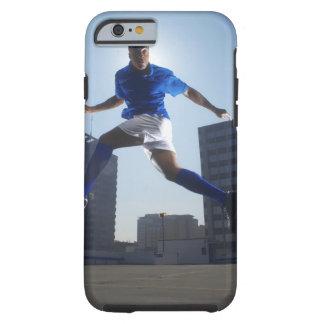 Man bouncing soccer ball on his head tough iPhone 6 case