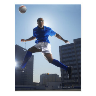 Man bouncing soccer ball on his head postcard