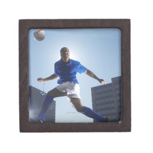 Man bouncing soccer ball on his head premium gift box