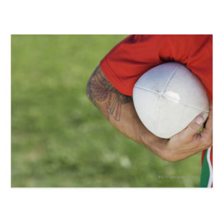 Man carrying rugby ball post card