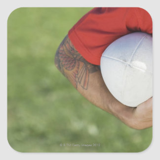Man carrying rugby ball square sticker