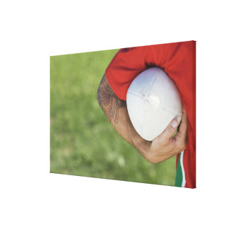 Man carrying rugby ball stretched canvas print