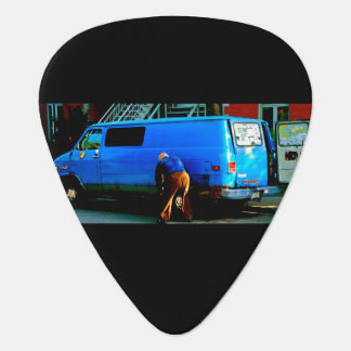 Man changing tire in Montreal Guitar Pick