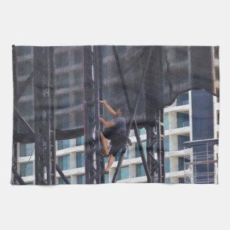 Man climbing up a steel ladder kitchen towel