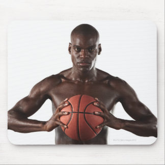 Man clutching basketball mouse pad
