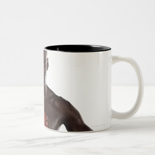 Man clutching basketball Two-Tone coffee mug