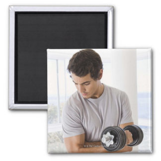 Man doing arm curls with weights magnet