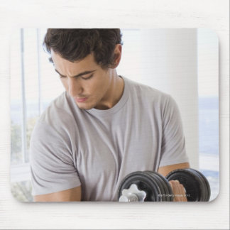 Man doing arm curls with weights mouse pad