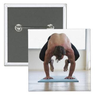 Man doing workout on yoga mat button