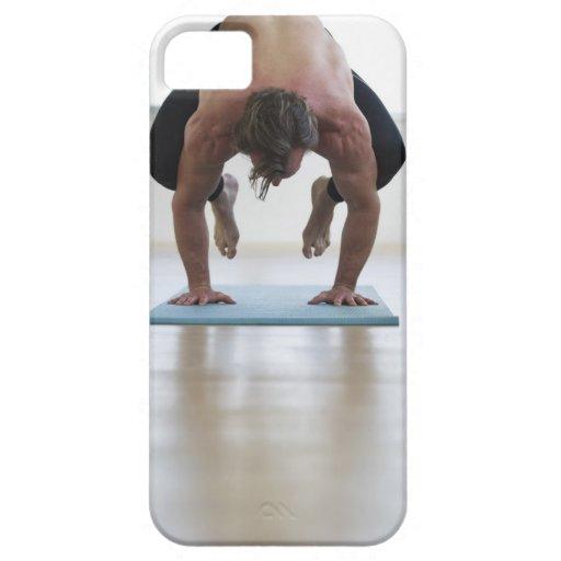 Man doing workout on yoga mat iPhone 5 case