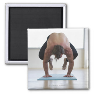 Man doing workout on yoga mat magnet