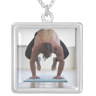 Man doing workout on yoga mat silver plated necklace