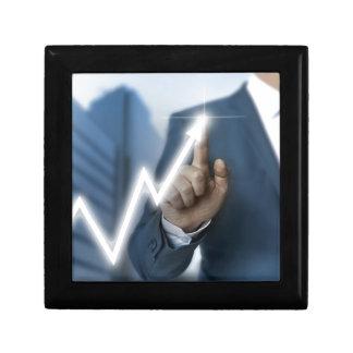 Man draws stock price touchscreen concept gift box