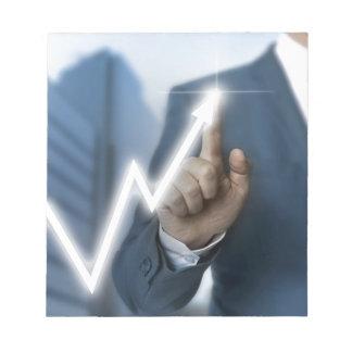 Man draws stock price touchscreen concept notepad
