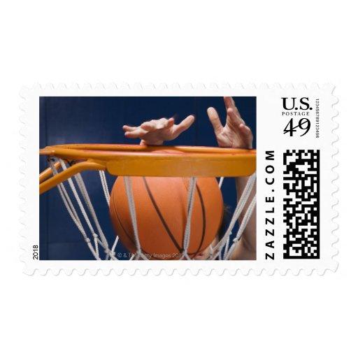 Man dunking basketball postage stamp