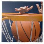 Man dunking basketball tiles