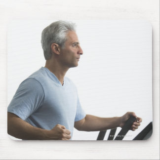 Man exercising on Stairmaster Mouse Pads