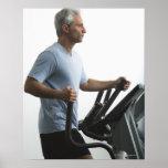 Man exercising on Stairmaster Poster