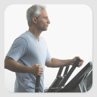 Man exercising on Stairmaster Square Sticker