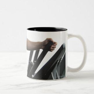 Man exercising on Stairmaster Two-Tone Coffee Mug
