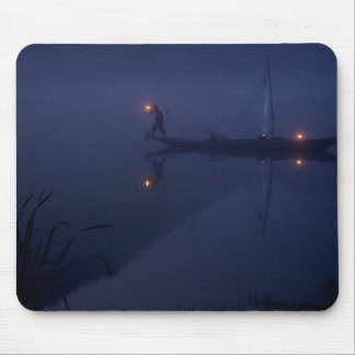 Man fishes with a net after dark mouse pad