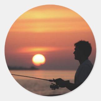 Man fishing in sunset sticker