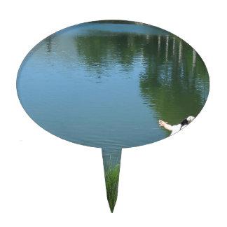 Man fly fishing on a mountain lake cake topper