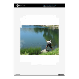 Man fly fishing on a mountain lake skins for the iPad 2