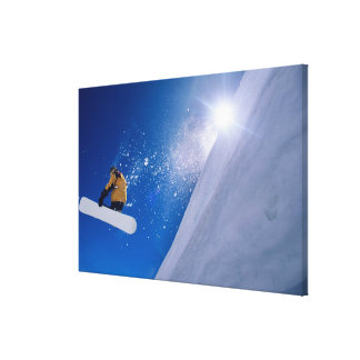 Man flying through the air on a snowboard with gallery wrap canvas