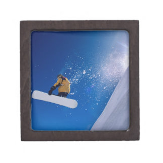 Man flying through the air on a snowboard with premium keepsake box